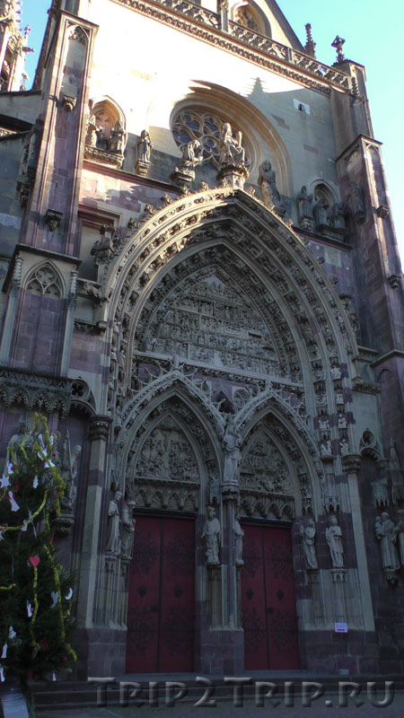 Портал церкви Сен-Тибо, Тан